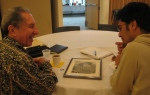 John sharing memories with astudent